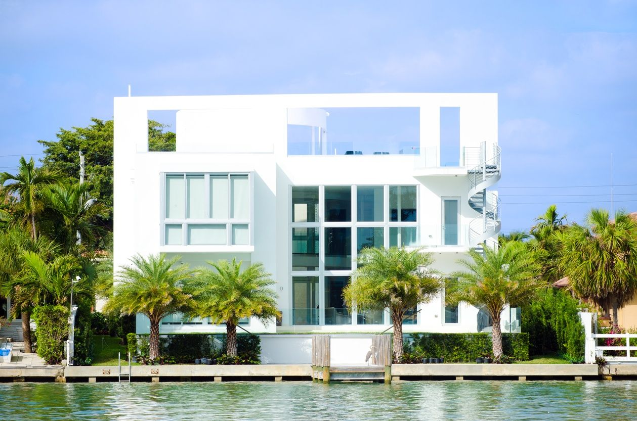 a gorgeous and modern white miami mansion on the waterfront
