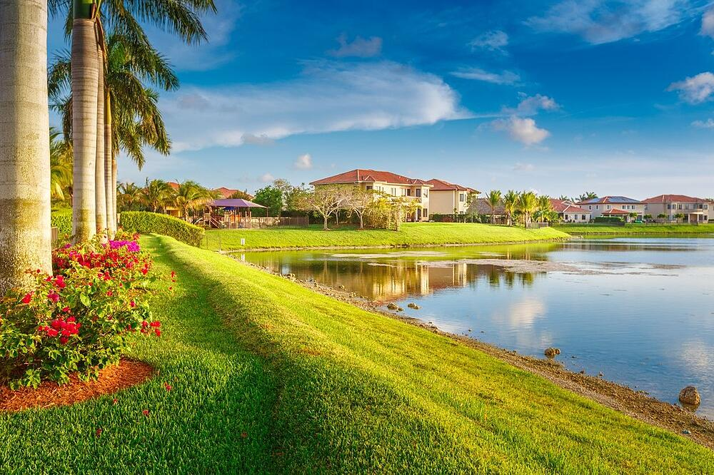 a picture of waterfront homes on a sunny day in Coconut Grove Miami