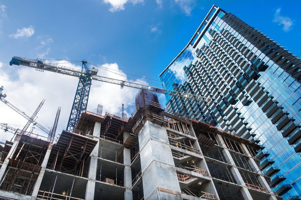 image of a pre-construcion condo in miami with blue sky in the background