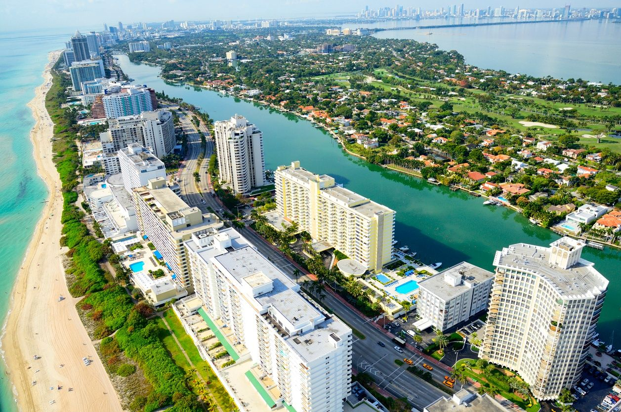 an aerial view of the beach and skyscrapers in Miami beach