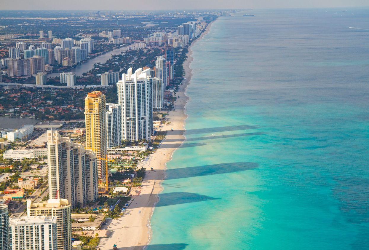 an overhead view of high-rise condo buildings along Miami Beach