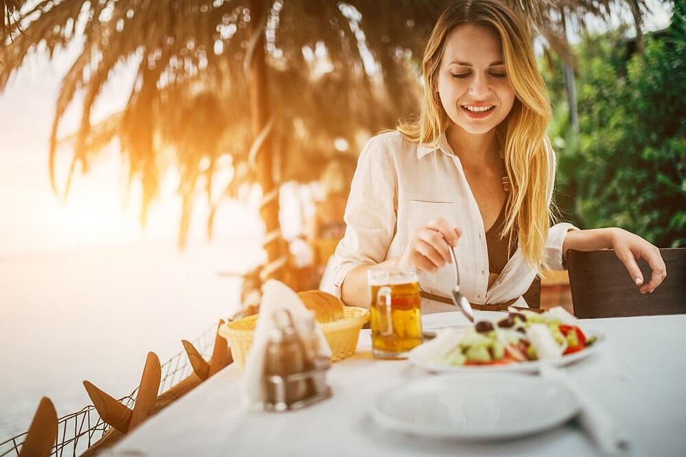 woman enjoying a fine dining meal in Coconut Grove Miami
